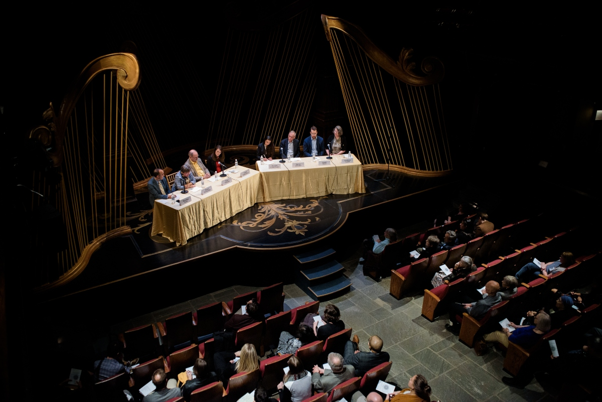 Overhead photograph of stage and audience, Folger Institute Roundtable
