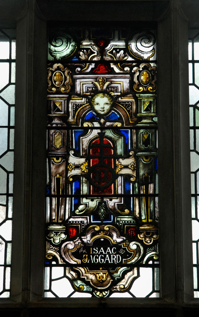 Stained-glass window with the name of Isaac Jaggard
