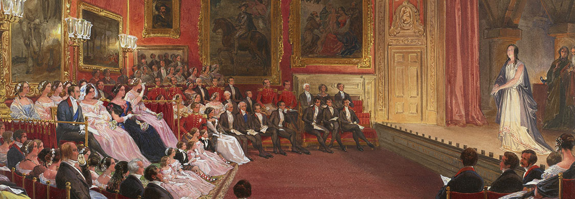 Queen Victoria, surrounded by courtiers in black tie, watches a performance of Macbeth in a sumptuously decorated room in Windsor Palace.