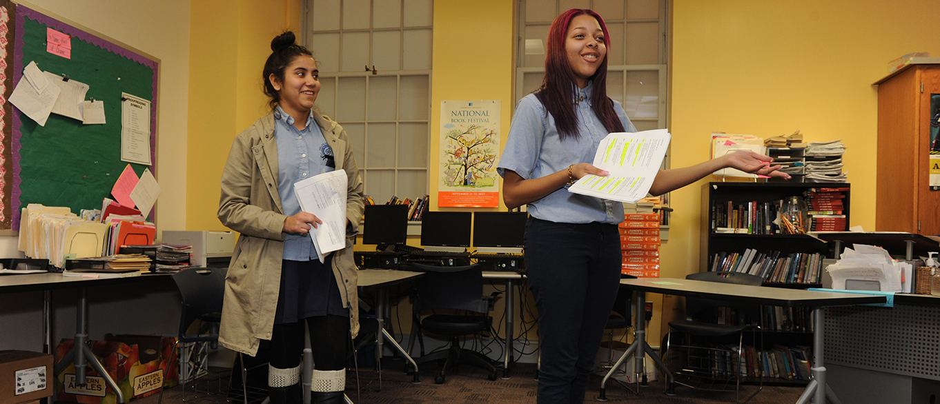 Two students participating in a Folger program in the classroom at Phelps High School in DC