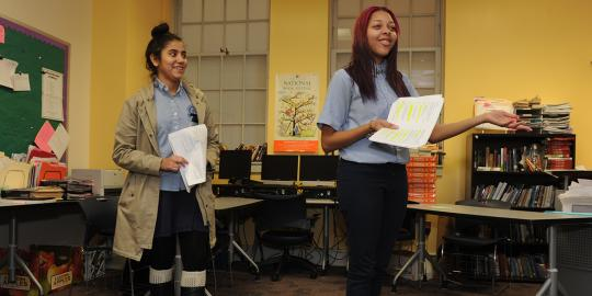 Two students doing a Folger program in the classroom at Phelps High School in DC